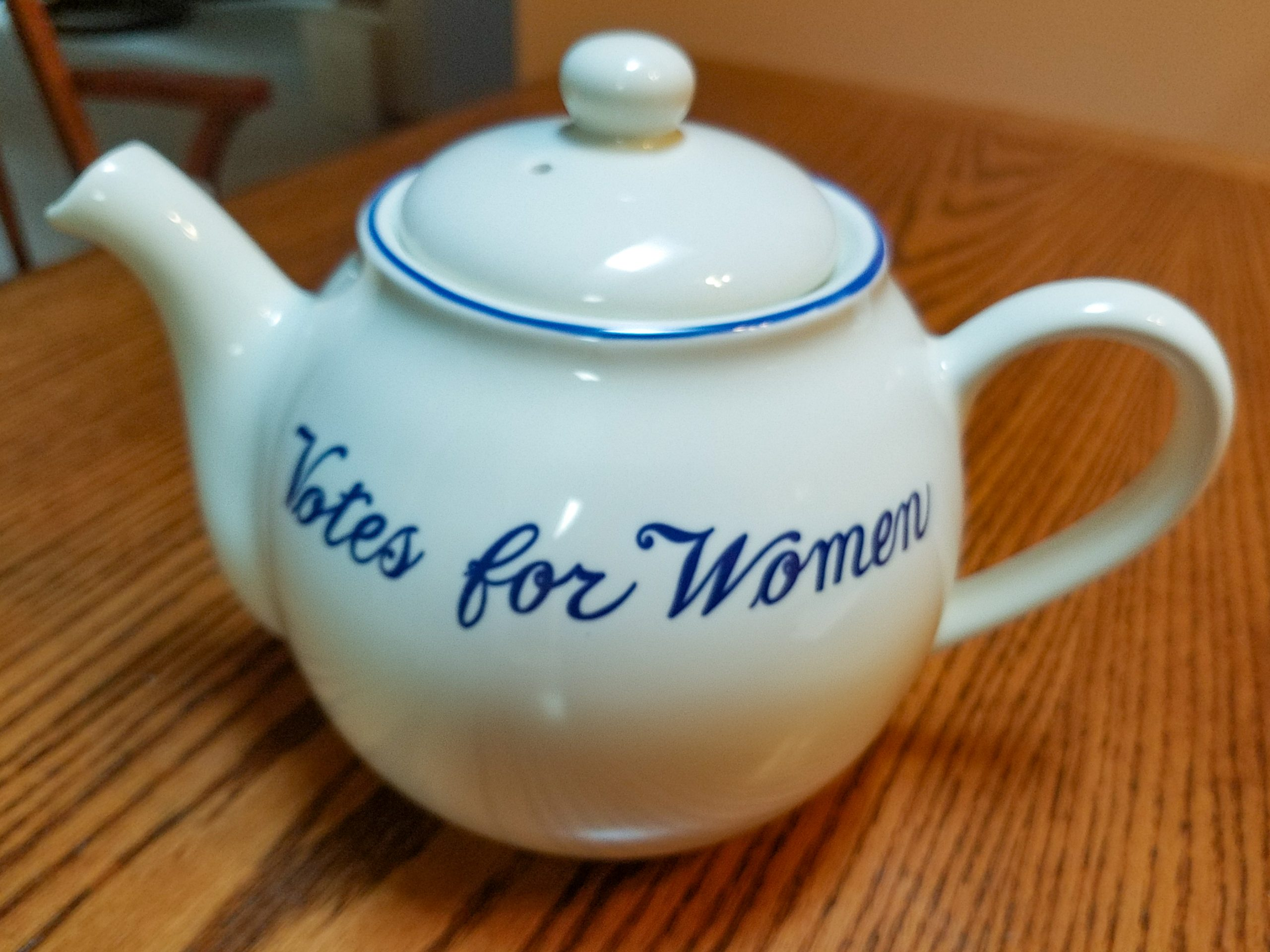 white teapot with the words: Votes for Women